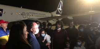 Romanian foreign minister Bogdan Aurescu with Afghan evacuees in Bucharest